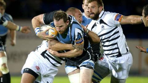 Morrison is held up as he races for the Zebre line at Scotstoun