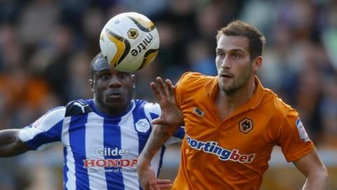 Roger Johnson of Wolves (R) battles for the ball with Michail Antonio of Sheffield Wednesday