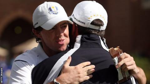Rory McIlroy embraces European Ryder Cup skipper Jose Maria Olazabal after his late arrival for Sunday's singles