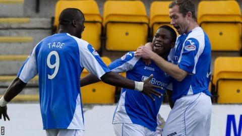 Gregory Tade congratulates goalscorer Nigel Hasselbaink