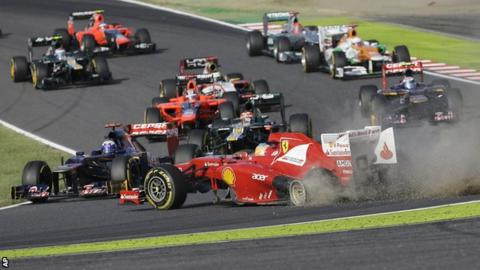 Ferrari driver Fernando Alonso of Spain spins off the track at the start of the Japanese Formula 1 Grand Prix at the Suzuka Circuit