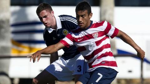 Scotland's Clark Robertson closes down American goalscorer Jose Villarreal