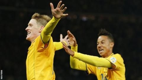 Rasmus Elm celebrates with his team mate Tobias Sana after scoring Sweden's late equaliser