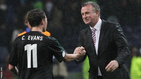 Michael O'Neill celebrates with Corry Evans after the final whistle in Porto