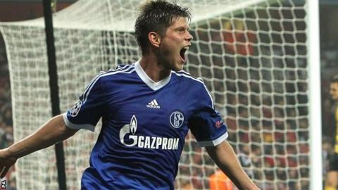 Schalke's Klaas-Jan Huntelaar (right)celebrates scoring their first goal