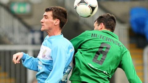 Match action from Ballymena United against Ballinamallard