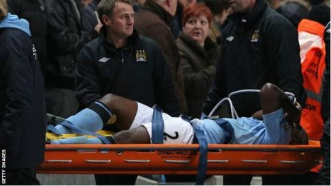 Micah Richards is carried off on a stretcher
