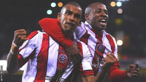 Nick Blackman of Sheffield United (left) is congratulated on scoring by Matt Hill