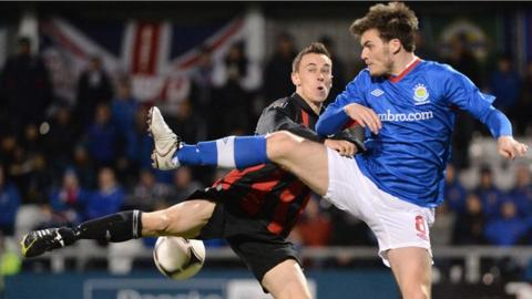 Paul Heatley of Crusaders and Linfield's Philip Lowry