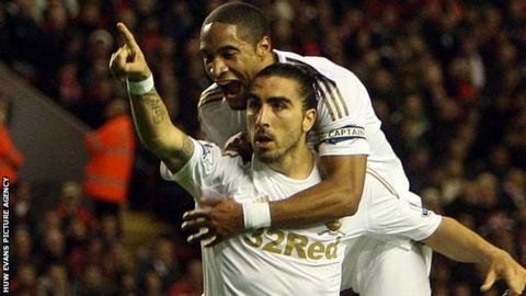 Ashley Williams celebrates with Chico Flores