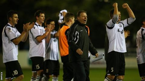 Cambridge City's management and players celebrate