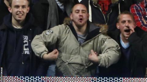Fan in alleged racist gesture