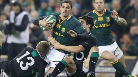 South Africa's Ruan Pienaar is tackled by Keith Earls and Conor Murray of Ireland