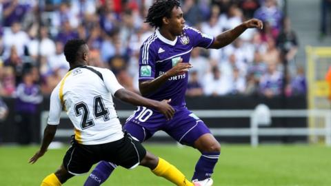 Patosi (left) playing for Lokeren against Anderlecht
