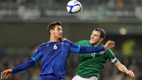 John O'Shea battles with Alexandros Tziolis at the Aviva Stadium