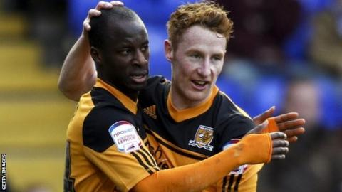 Hull's Sone Aluko celebrates his second goal with Stephen Quinn