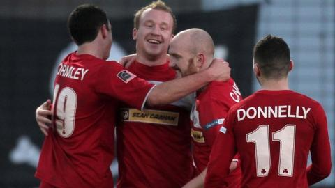 Cliftonville players celebrate the 8-0 victory over Ballymena United