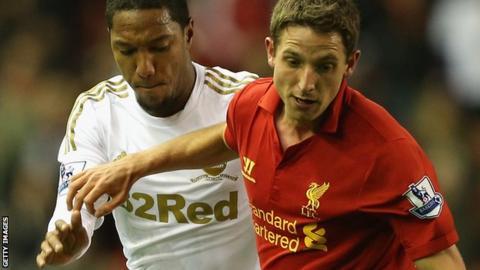 Joe Allen holds off Swansea's Jonathan de Guzman