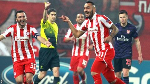 Kostas Mitroglou celebrates scoring the winner for Olympiakos against Arsenal