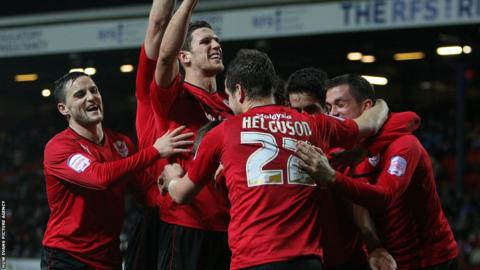 Cardiff City's players celebrate a goal in Blackburn