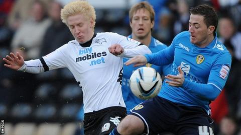 Derby's Will Hughes (left) and Ross McCormack of Leeds
