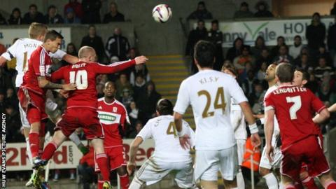 Seb Hines heads into his own net to give Swansea City victory