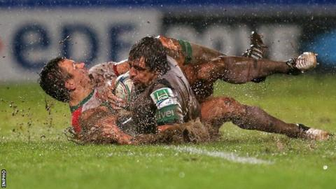 Damien Traille tackles Mike McCarthy at a rain-lashed Parc des Sports Aguilera in Biarritz