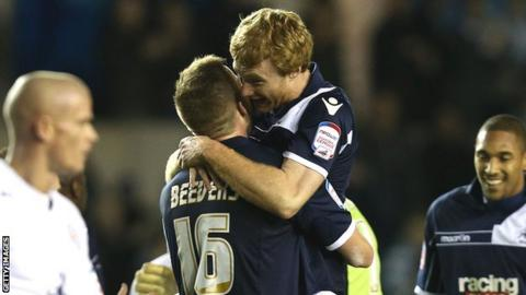 Chris Taylor of Millwall celebrates the win with team mate Mark Beevers
