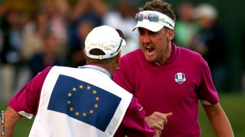 Ian Poulter celebrates with his caddy
