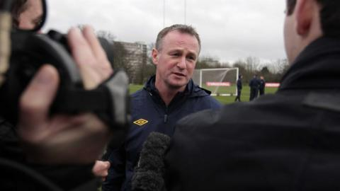 O'Neill answers questions from the media at a Northern Ireland training session before his first game against Norway