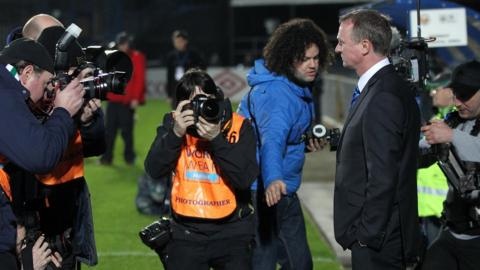 Photographers scramble to get the shot as O'Neill takes charge of Northern Ireland for the first time at Windsor Park