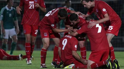 Da Mota's 86th minute shot deflected off Ryan McGivern to give Luxembourg a 1-1 draw in a World Cup qualifier in Belfast