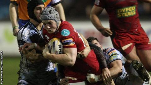 Scarlets' Jonathan Davies is brought down