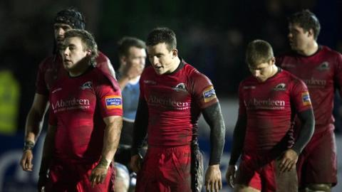 A bedraggled Edinburgh leave the field after losing to Glasgow