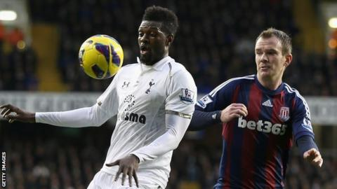 Emmanuel Adebayor and Glenn Whelan