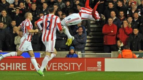 Stoke City's Trinidadian striker Kenwyne Jones (right) celebrates scoring their second goal as teammates US defender Geoff Cameron (second left) and Irish striker Jonathan Walters (left) join in