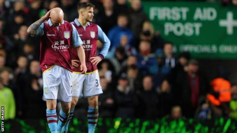 Dejected Aston Villa players Stephen Ireland and Chris Herd