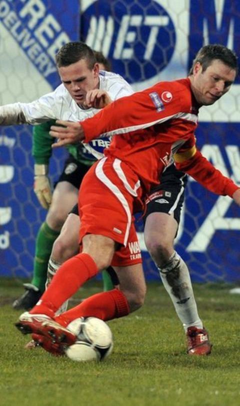 Coleraine's Aaron Canning challenges Portadown striker Kevin Braniff at Shamrock Park