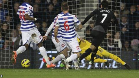 Liverpool striker Luis Suarez (right) scores against QPR