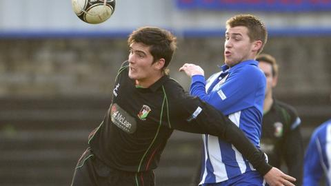 Glentoran's Jimmy Callacher in action against Stephen Lowry of Coleraine