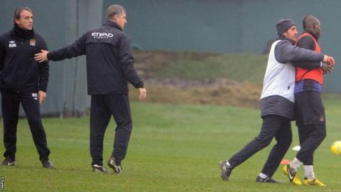 Roberto Mancini (second left) and Mario Balotelli (far right)