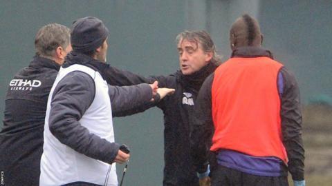 Mario Balotelli (far right) and Roberto Mancini (second right)