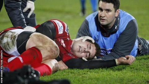 George North receives treatment at Ravenhill