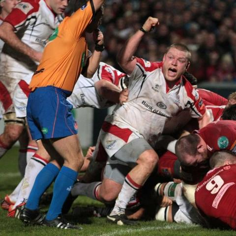 Tom Court celebrates as Nick Williams drives over to score Ulster's second try against the Scarlets