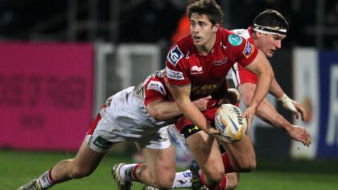 Ulster's Luke Marshall tackles Scarlets fly-half Aled Thomas during the Pro12 clash in Belfast