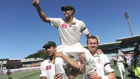 Australian cricketer Michael Hussey (C) is carried off the field by Peter Siddle (R) and Mitchell Johnson (L) after defeating Sri Lanka