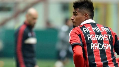 AC Milan's Ghana defender Kevin-Prince Boateng warms up, wearing a jersey against the racism
