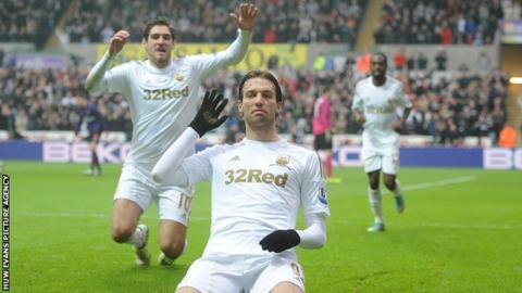 Michu celebrates after scoring against Arsenal