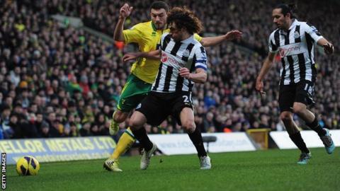 Fabricio Coloccini (middle) tackles Norwich midfielder Robert Snodgrass