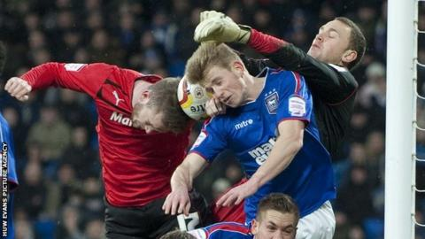 Cardiff City's Aron Gunnarsson has a header blocked by the Ipswich defence